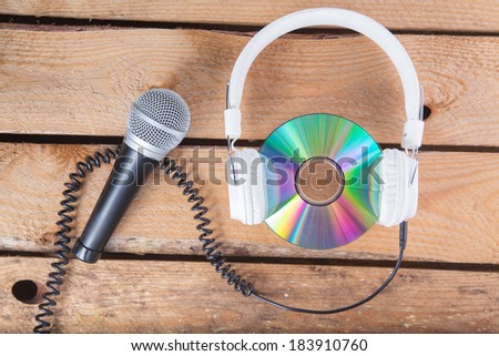 cd and microphone - stock photo