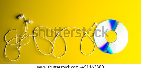 CD disc and headphone - stock photo
