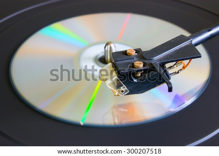 cd disc on a turntable close-up side view selective focus - stock photo