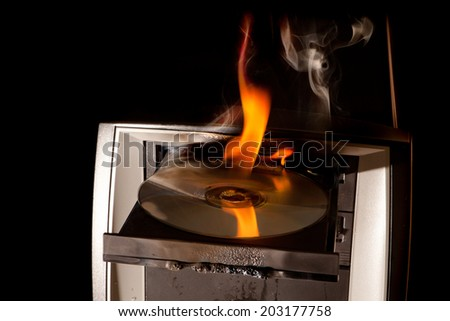 CD drive of a computer on fire and melting