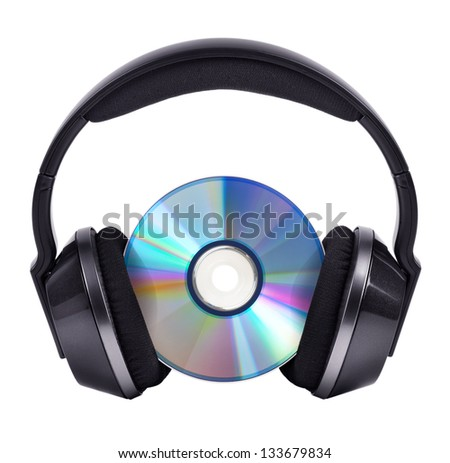 CD in big black wireless stereo headphones - stock photo