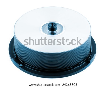 CD or DVD discs on a spindle. Blue toned. - stock photo