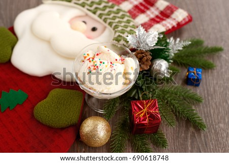 ce cream and Santa Claus. Gift sock in the form of Santa Claus and ice cream for the new year. Cold dessert and Santa Claus create a New Year's mood. Ice cream in the new year.