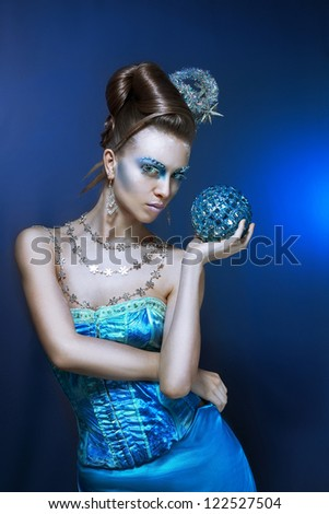 ce-queen. Young woman in creative image with silver artistic make-up. - stock photo