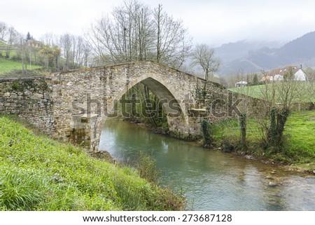 Ceceda medieval bridge in Asturias, Spain - stock photo