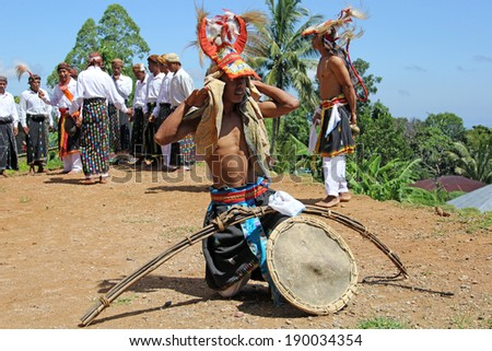 Cecer Village, Indonesia-Apr. 21: Caci dancer prepares for traditional dance by wrapping protective gear around his head to protect from a whip wielding foe on Flores Island on April 21, 2014 - stock photo