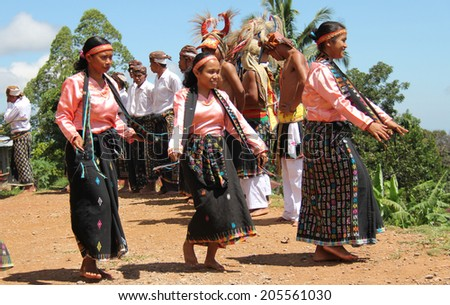 Cecer Village, Indonesia-Apr.21: Women perform a traditional dance in costume for tourists visiting the village on Flores Island on April 21, 2014. - stock photo