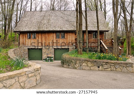 Cedar Log Cabin Chalet in a beautiful, wooded forest setting, secluded from everything. - stock photo