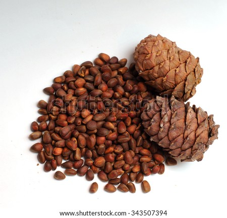 Cedar Pine nuts on a white background - stock photo