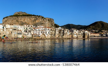 "CEFALU, ITALY - AUGUST 20 2016: The city of Cefalu, the ancient Kephalodion - a Greek term that means ""Head"" and refers to the natural shape of the Rock which dominates the city."