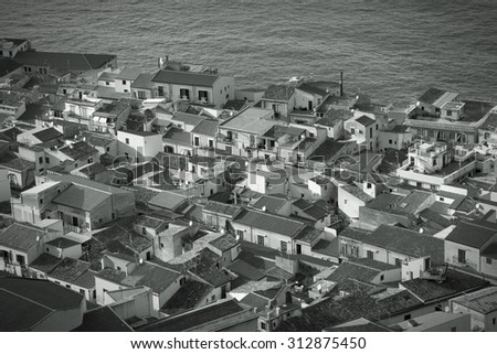 Cefalu, Sicily island in Italy. Aerial view of beautiful Mediterranean town. Province of Palermo. Black and white tone - retro monochrome BW color style. - stock photo