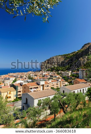 Cefalu town seen from above on a hot summer day, Sicily, Italy.