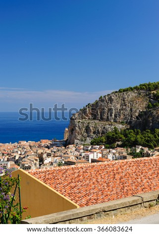 Cefalu town seen from above on a hot summer day, Sicily, Italy. - stock photo