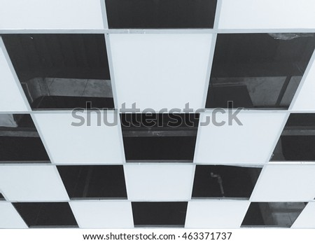 Ceiling board pattern for background.