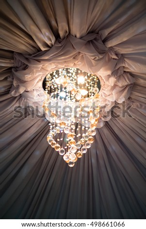Ceiling drape sparkling chandelier near center stock photo ceiling drape with sparkling chandelier near the center area professionally done for any venue of mozeypictures Image collections
