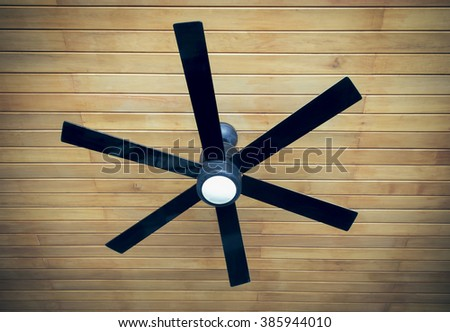 ceiling fan on a wooden ceiling