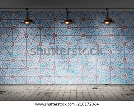 Ceiling lamp in tile room - stock photo