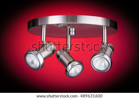 Ceiling light fixture isolated on red background