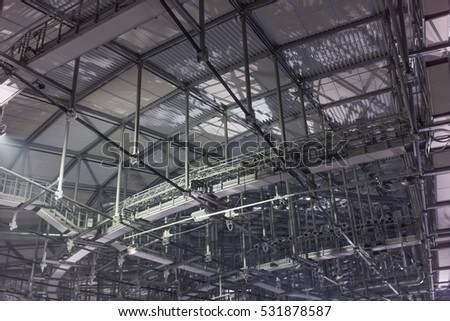 Ceiling slabs in industrial buildings in evening time with artificial lighting