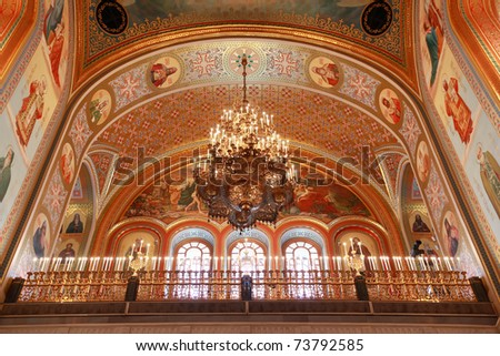 Ceiling with lusters adorned by candles inside Cathedral of Christ the Saviour in Moscow, Russia - stock photo