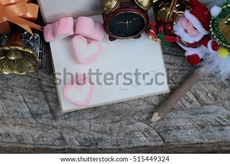 Celebrate Christmas decoration with pink heart marshmallow