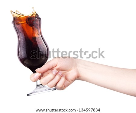celebrate the holiday background - hand with cola making toast - stock photo