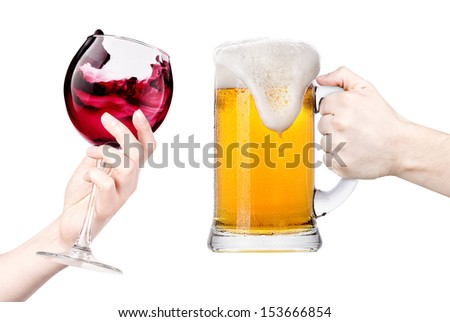 celebrate the holiday background - hands with wine and beer making toast - stock photo