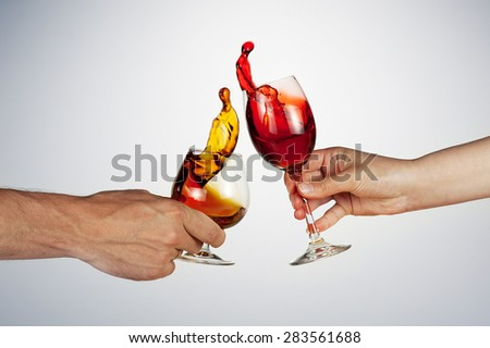 celebrate the holiday background - two hand with alcohol clinking - wonderful splashes - stock photo