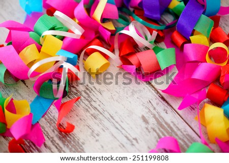 Celebrating a special day. Top view image of multicolored confetti as a frame for copy space on wooden table - stock photo