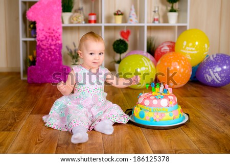 Celebrating first birthday - stock photo