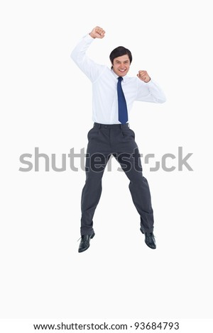 Celebrating tradesman jumping against a white background