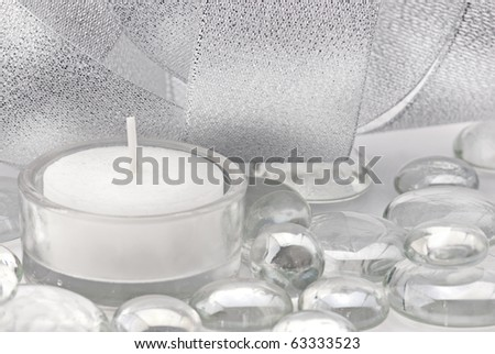 Celebration background. Silver decoration with candles, glass drops and shining ribbon - stock photo