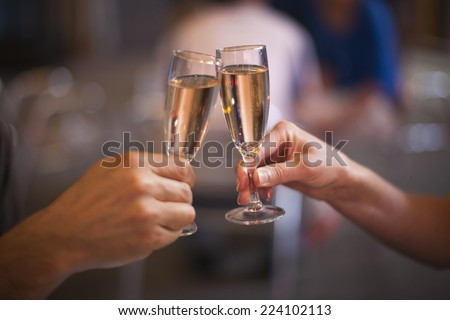Celebration: cheering with a glass of champagne