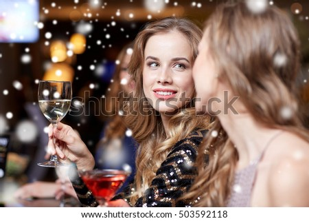 celebration, friends, bachelorette party and holidays concept - happy women drinking champagne and cocktails at night club