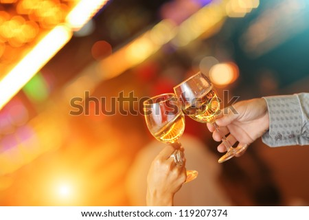 Celebration. Hands holding glasses making toast. - stock photo