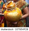 Celebration of Bonalu festival in Monsoon at India. People visit temples to offer holy meals in big brass pots for the Goddess of power - stock photo