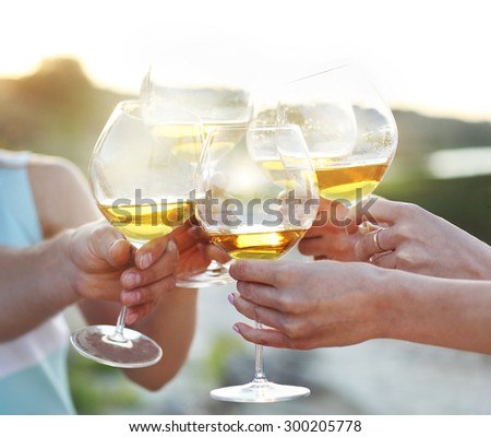 Celebration. People holding glasses of red wine making a toast - stock photo