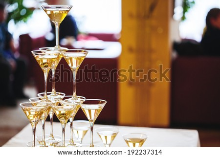 Celebration. Pyramid of champagne glasses. Gently toned. - stock photo