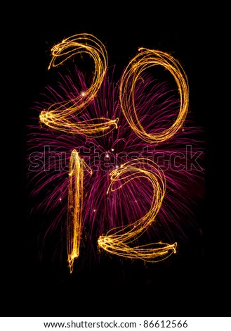 Celebration sparklers writing 2012 against black background. Vertical in two lines with pink fireworks. - stock photo