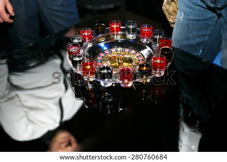 celebration table style casino roulette drinking game - stock photo