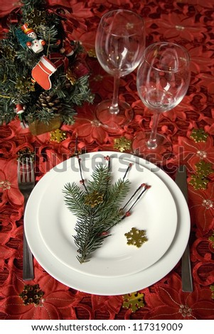Celebration table with christmas decoration in red tone