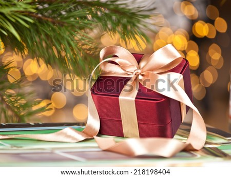 Celebration theme with christmas gifts. Gift box in shiny gold night - stock photo