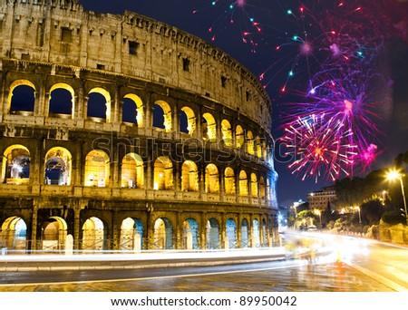 Celebratory fireworks over Collosseo. Italy. Rome - stock photo