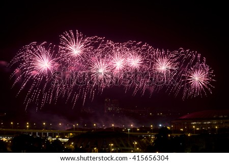 Celebratory fireworks over night city Moscow, Russia - stock photo