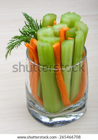 Celery and carrot sticks in the glass - stock photo