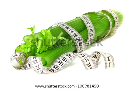 Celery and measure tape diet concept isolated on white