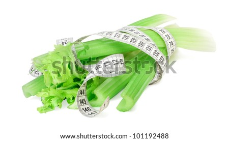 Celery and measure tape diet concept isolated on white - stock photo