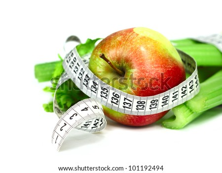 Celery apple and measure tape diet concept isolated on white corner composition - stock photo