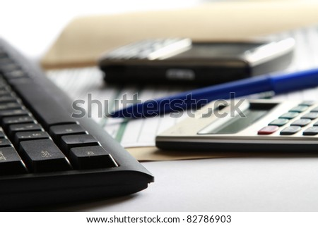 Cell and calculator on laptop