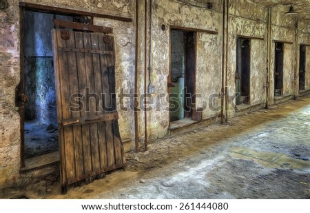 Cell Block with Old Wooden Door at Eastern State Penitentiary in Philadelphia, Pennsylvania - stock photo